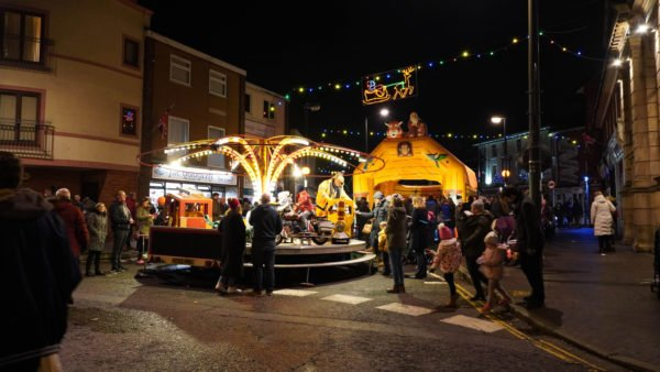 Fun Fair ride in the centre of Newport Pagnell High Street for the Christmas Lights switch on