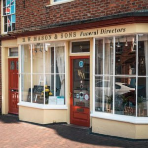 Shop front for H.W. Mason & Sons funeral directors in Newport Pagnell High Street.