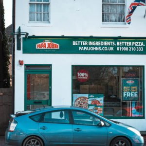 Shop front for Papa Johns Pizza in Newport Pagnell High Street