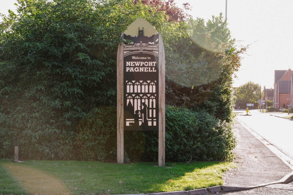 Newport Pagnell Gateway sign representing Priory.